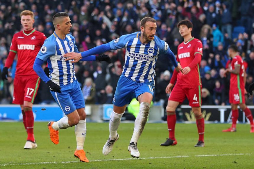 Brighton's Glenn Murray celebrates scoring their second goal with Anthony Knockaert.
