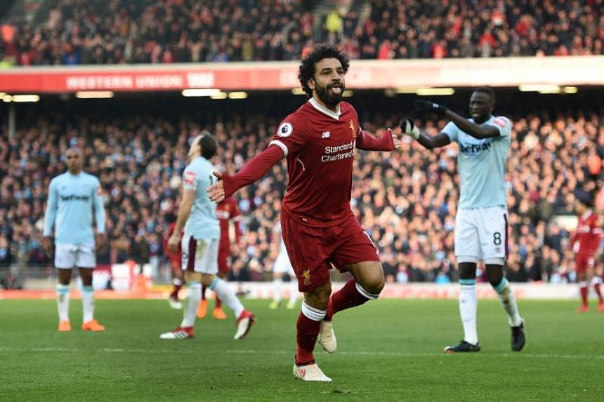 Liverpool's Egyptian midfielder Mohamed Salah celebrates scoring the team's second goal during the English Premier League football match between Liverpool and West Ham United at Anfield in Liverpool, north west England on Feb 24, 2018.