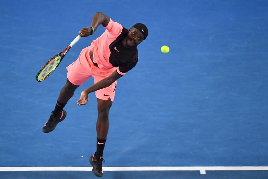 Frances Tiafoe of the US serves during his men's singles first round match against Argentina's Juan Martin del Potro on day two of the Australian Open tennis tournament in Melbourne on Jan 16, 2018.