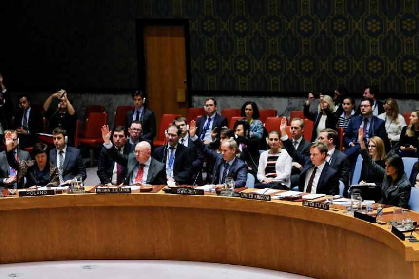 Members of the United Nations Security Council vote for ceasefire to Syrian bombing in eastern Ghouta, at the United Nations headquarters in New York, on Feb 24, 2018.