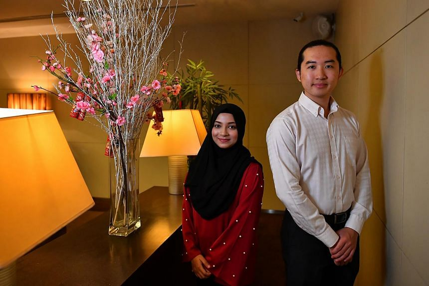 Mr Li Muhan (right), who was appointed an ambassador of peace and Ms Fahima Farha, one of the programme's organisers.