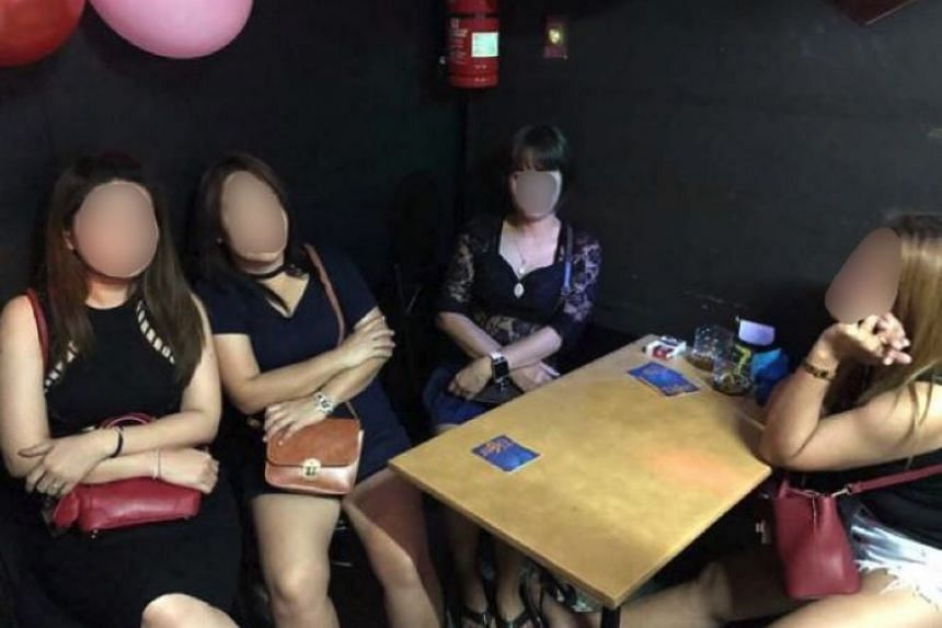 Police officers arrested six women and a man during enforcement checks on public entertainment outlets along Beach Road and Tras Street.