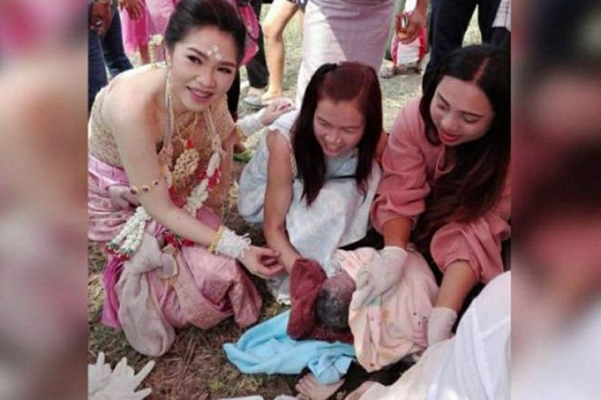A woman delivered a baby girl during her friend's wedding ceremony in Nakhon Ratchasima, Thailand, on Feb 24, 2018.