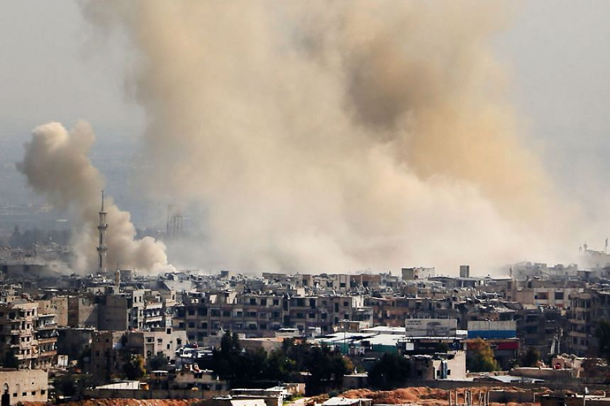 Smoke rising from areas targeted by Syrian army shelling in Arbin and Harasta, northeastern suburbs of Damascus, on Feb 21, 2018.