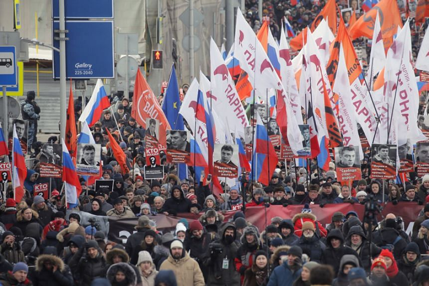 Russian liberal opposition activists march with portraits of a killed opposition leader Boris Nemtsov during a demonstration devoted to his memory in Moscow on Feb 25, 2018.