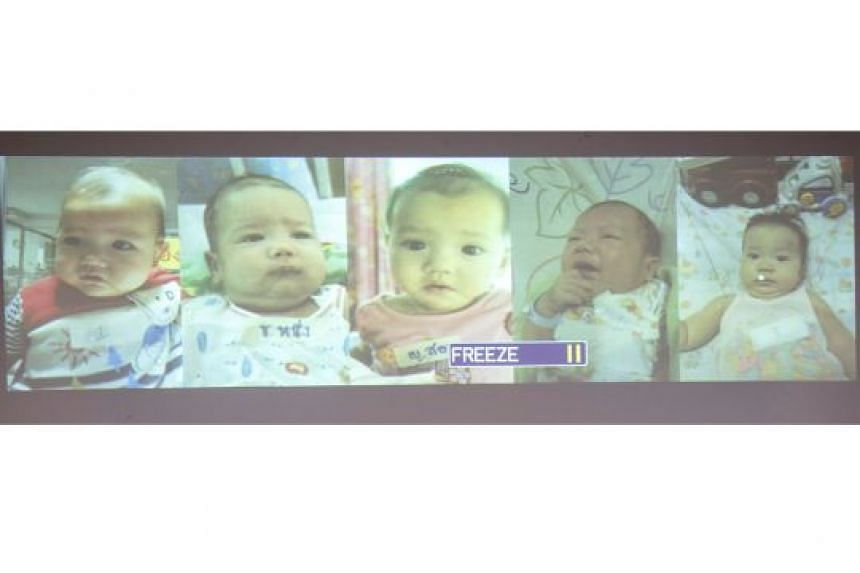 Five of the babies whom Thai police said could have been fathered by him.