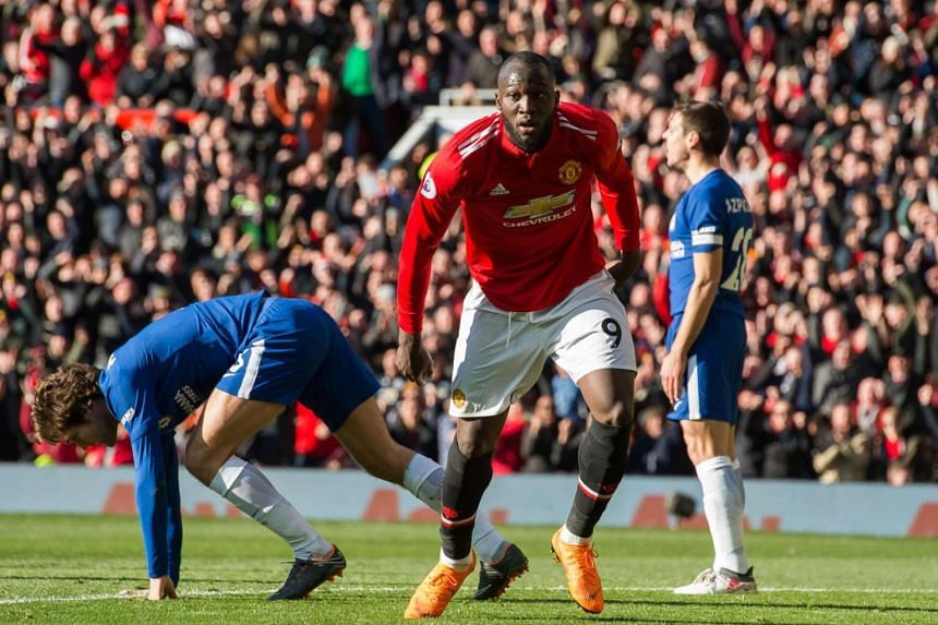 Manchester United's Romelu Lukaku (centre) celebrates scoring the equaliser during the English Premier League football match between Manchester United and Chelsea.