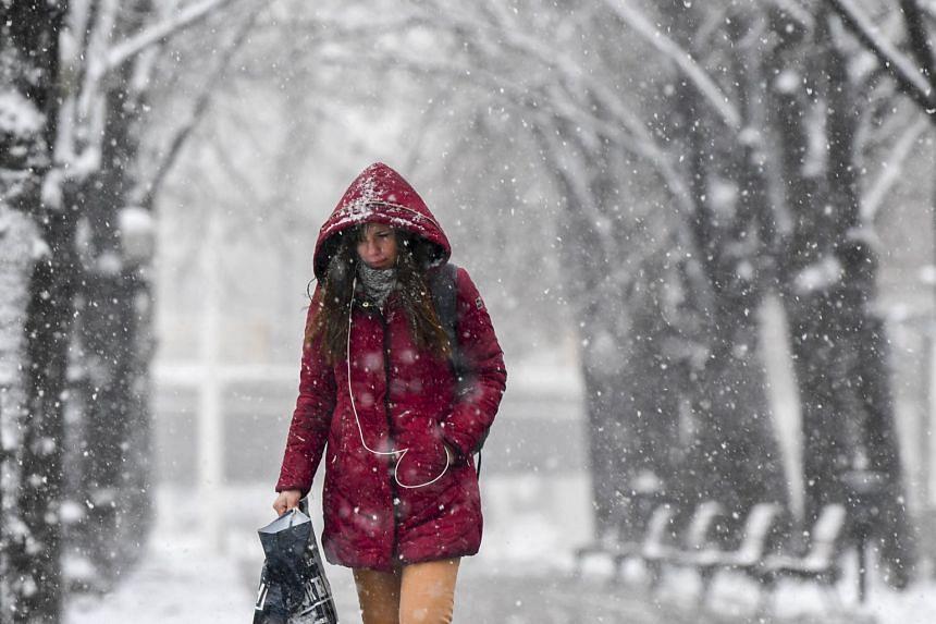 A girl walking amid snowfall in Skopje, Macedonia on Feb 25, 2018.
