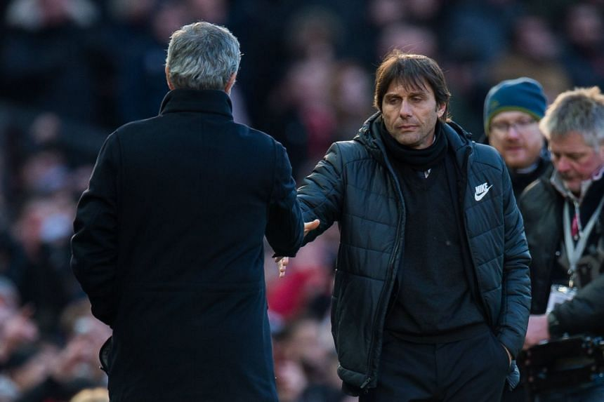 Antonio Conte (right) and  Jose Mourinho shake hands after the match.