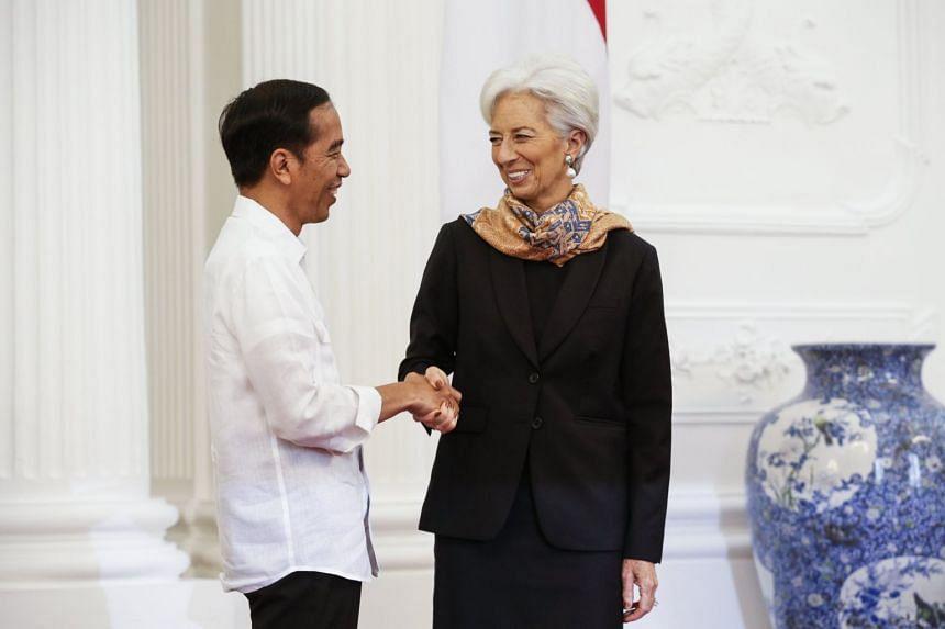 International Monetary Fund Managing Director Christine Lagarde is greeted by Indonesia's President Joko Widodo prior to their meeting at Merdeka Palace in Jakarta, on Feb 26, 2018.