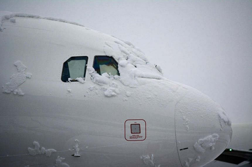 Hangar and airplanes on the runway are covered by snow during a snowfall at the Leonardo Da Vinci Rome airport, in Fiumicino, Italy, on Feb 26, 2018.
