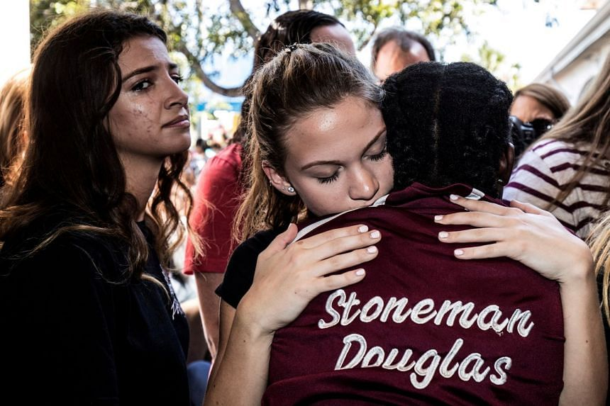 Students from Marjory Stoneman Douglas High School attend a memorial following the shooting.