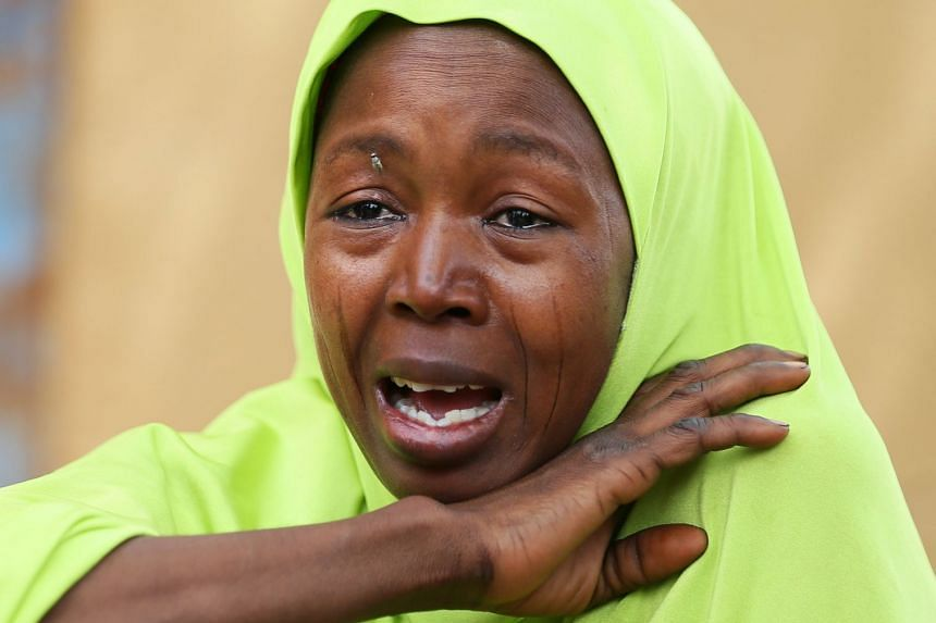 A relative of one of the missing schoolgirls reacting after the Boko Haram attack.