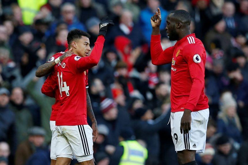 Jesse Lingard celebrates with Romelu Lukaku after scoring their second goal.