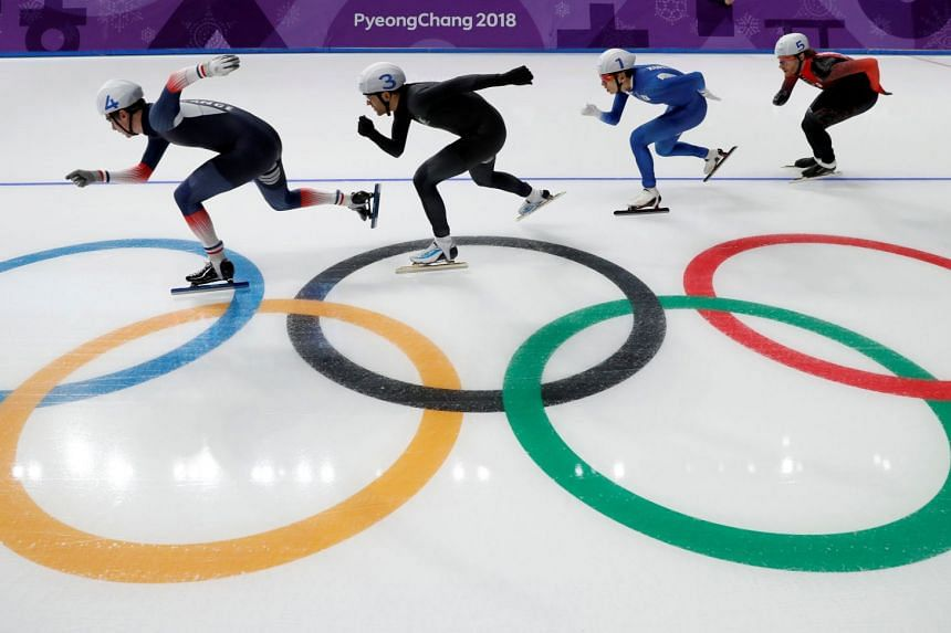 Athletes competing in the men's mass start speed-skating semi-final.