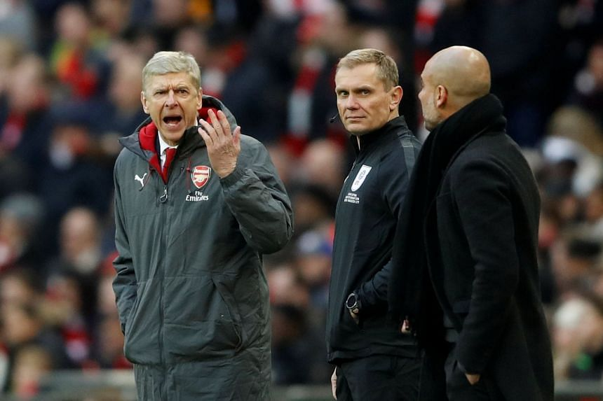 Wenger (left) and Manchester City's manager Pep Guardiola (right) react during the match.