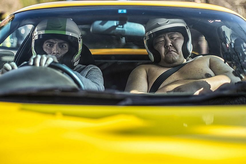 Top Gear host Chris Harris with a Japanese sumo wrestler in a scene from the TV series.
