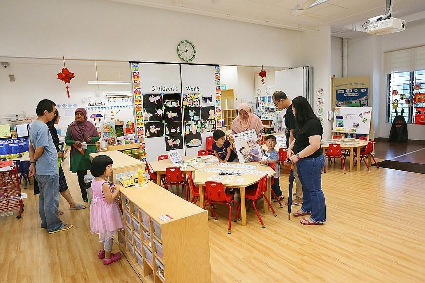 Parents and their children checking out the facilities during an open house at the MOE kindergarten situated within West Spring Primary School in Bukit Panjang Ring Road on Saturday.