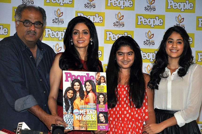Actress Sridevi with her husband, film producer Boney Kapoor, and daughters Khushi and Jhanvi (far right).