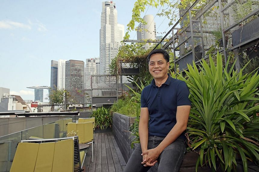 "Mr Chan Ee Mun at architecture firm Woha's urban farm on the office rooftop. ""In an architect's career, there are not many buildings that we do. But this (Punggol Digital District) is no longer about buildings - it is an organism,"" he says."