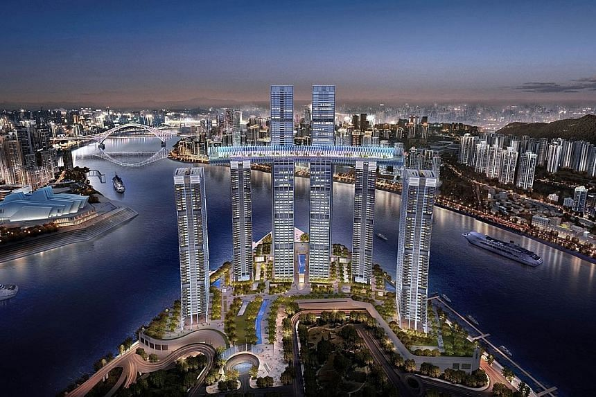 An artist's impression of Raffles City Chongqing. Opening in phases next year, the 24 billion yuan (S$5 billion) complex by CapitaLand and Ascendas-Singbridge comprises eight towers. It has the world's highest sky bridge - named The Conservatory - li