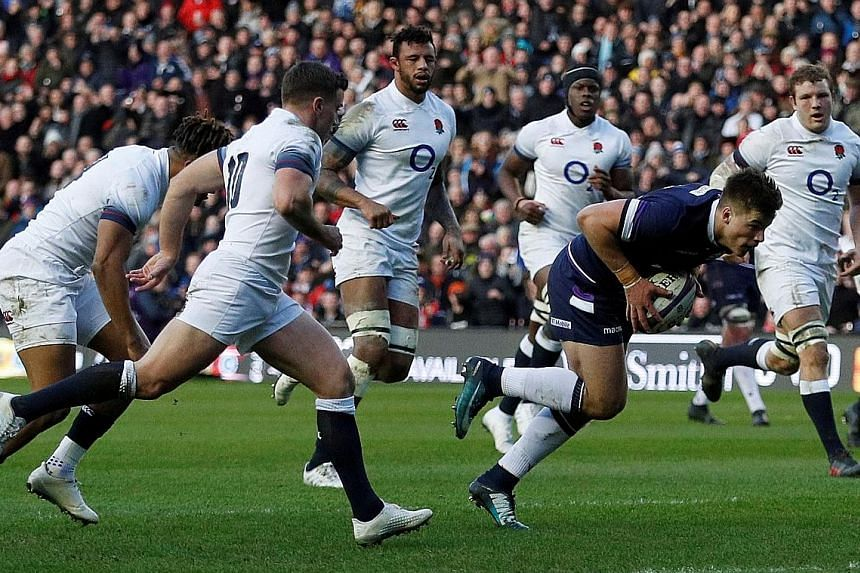 Huw Jones scoring Scotland's first try against England at Murrayfield Stadium on Saturday. The Scots' three tries in the first half were all the more remarkable as it was 14 years since they had last crossed England's try-line.
