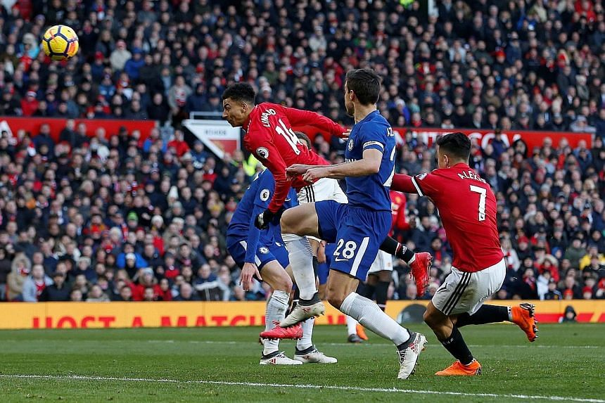 Manchester United substitute Jesse Lingard flings himself at a Romelu Lukaku cross to head in the winner in the 75th minute.