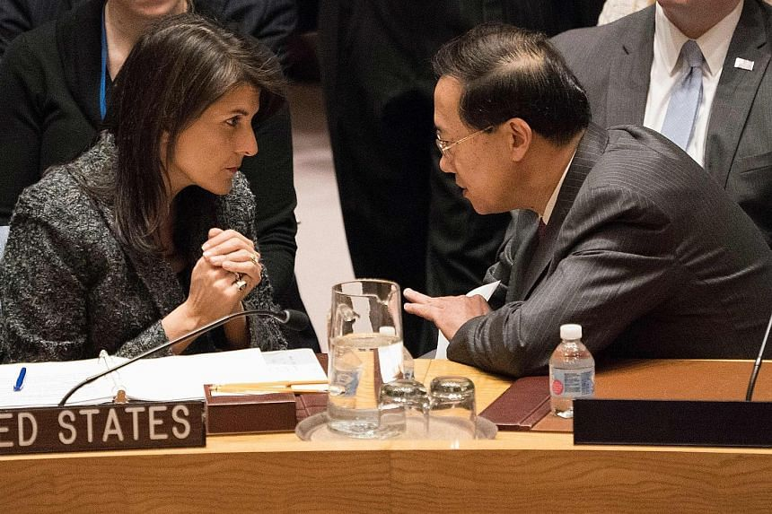 China's Ambassador to the United Nations Ma Zhaoxu speaking to the US Ambassador to the UN Nikki Haley during a United Nations Security Council meeting on a ceasefire in Syria on Saturday in New York. The council voted unanimously to demand the truce