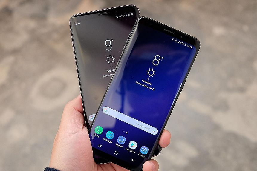Samsung's Galaxy S9+ (far left) and S9 will be available in Singapore next month. Their prices have not yet been announced. WATCH THE VIDEO First looks at the Samsung Galaxy S9/S9+ phones http://str.sg/ o5WH