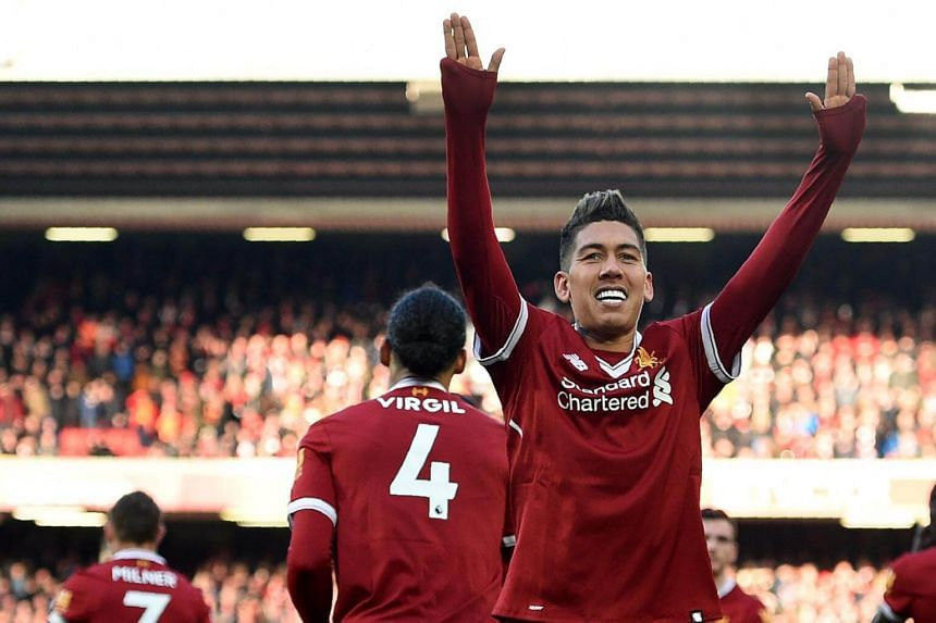Liverpool's Roberto Firmino celebrates scoring the team's third goal during the English Premier League football match between against West Ham United in Liverpool on Feb 24, 2018.