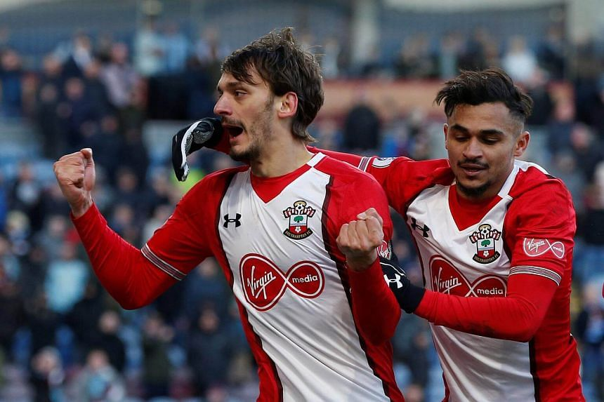 Manolo Gabbiadini (left) celebrates a goal during Southampton's match against Burnley on Feb 24, 2018.