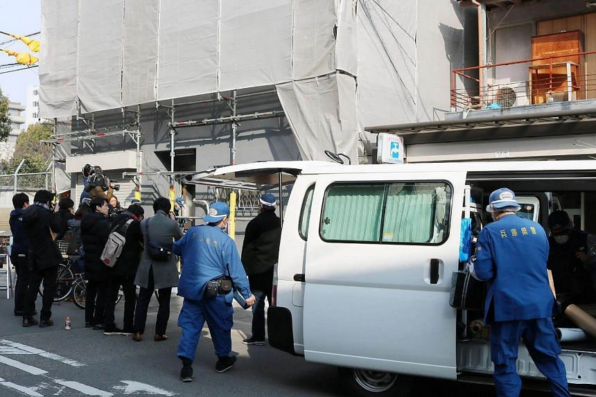 Prefectural police investigating the apartment where a decapitated head was found in Osaka, Japan, on Feb 25, 2018.