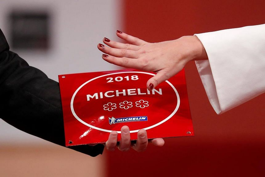 A plaque with the 2018 three Michelin stars is displayed during the Michelin Guide 2018 award ceremony at the Seine Musicale center in France on Feb 5, 2018.