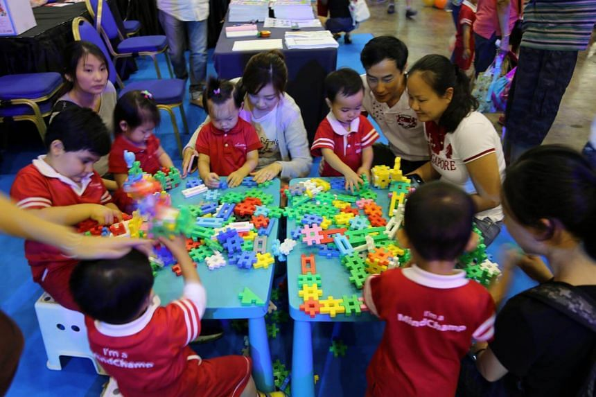 Pre-schoolers of MindChamps and their parents at a family festival to mark Children's Day on Oct 6, 2017.