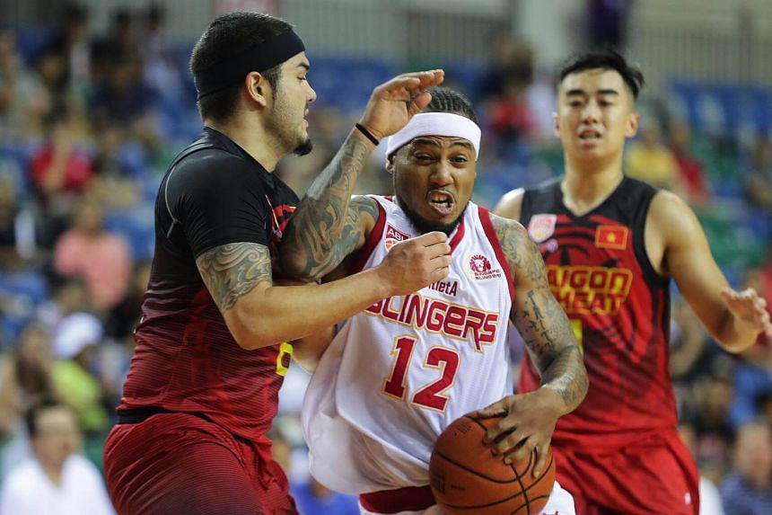 Singapore Slingers' AJ Mandani (centre) scored a game-high 25 points in his team's 94-76 victory over Saigon Heat.