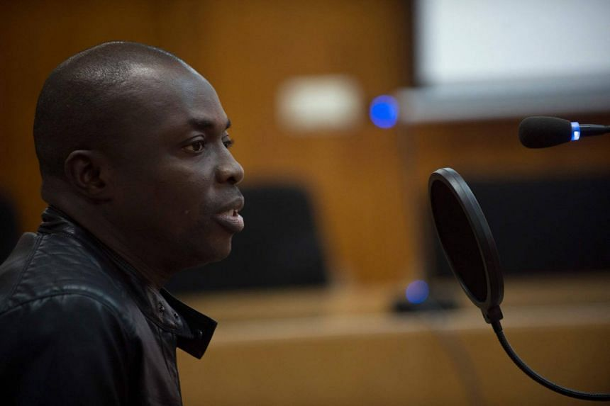 Ali Ouattara, 45, sits in court during his trial in Ceuta, a Spanish overseas territory in northern Morocco, on Feb 20, 2018.