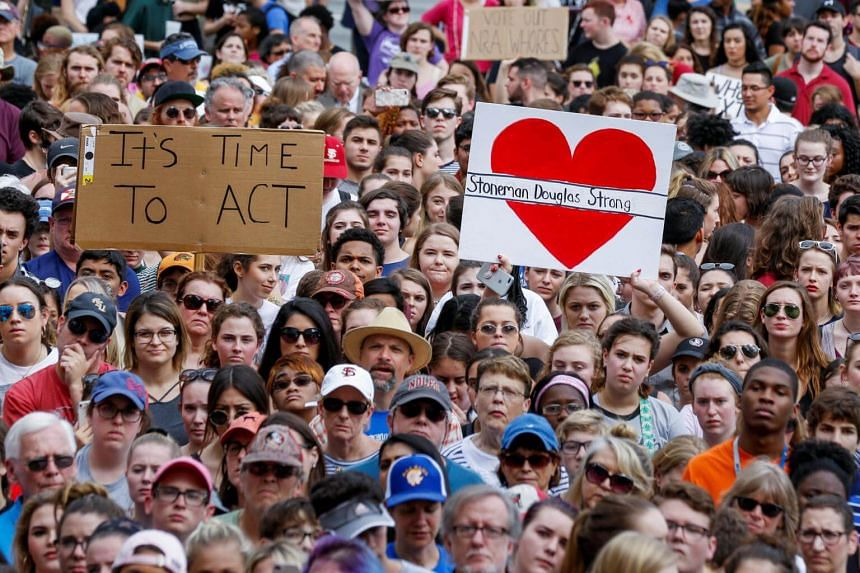 Protestors rally outside the Capitol urging Florida lawmakers to reform gun laws, in the wake of the a shooting at Marjory Stoneman Douglas High School, in Tallahassee, Florida on Feb 21, 2018.