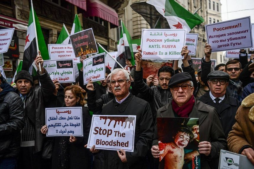 Syrian opposition politician George Sabra (centre) joins the protest against the airstrikes and shelling in Ghouta, in front of the Russian Consulate in Istanbul, on Feb 22, 2018.