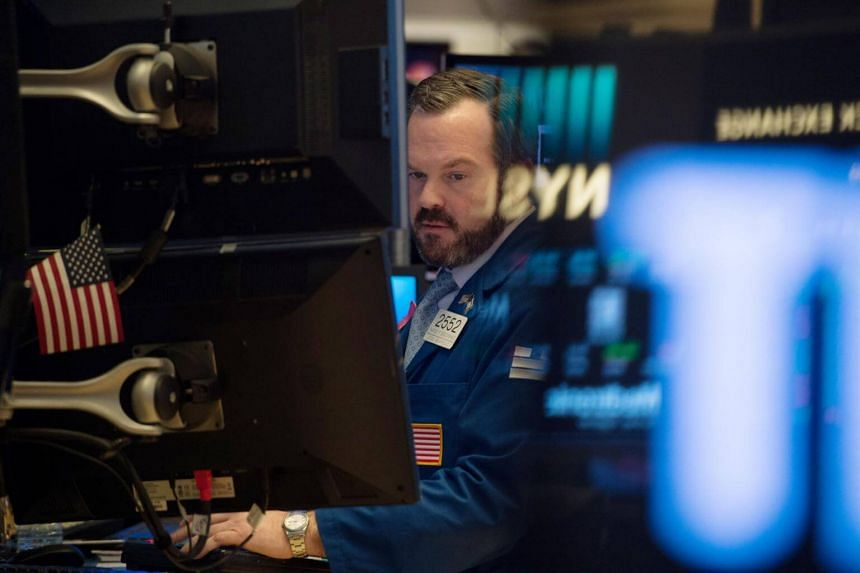 Traders work on the floor at the closing bell of the Dow Industrial Average at the New York Stock Exchange on Feb 22, 2018, in New York.