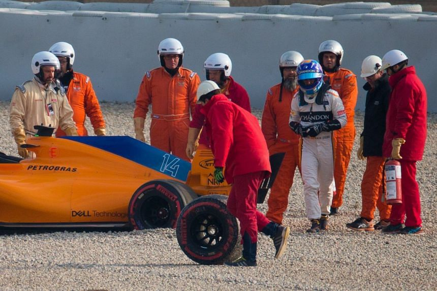 Formula One driver Fernando Alonso (centre) leaves his car after going into the gravel during the F1 Test Days 2018, aon Feb 26, 2018.