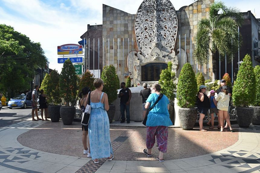 Tourists visit the monument to commemorate the victims of the 2002 Bali bombings in Kuta on Feb 26, 2018. More than 100 former Indonesian militants, including those involved in the Bali bombings, will be meeting survivors of attacks and families of t