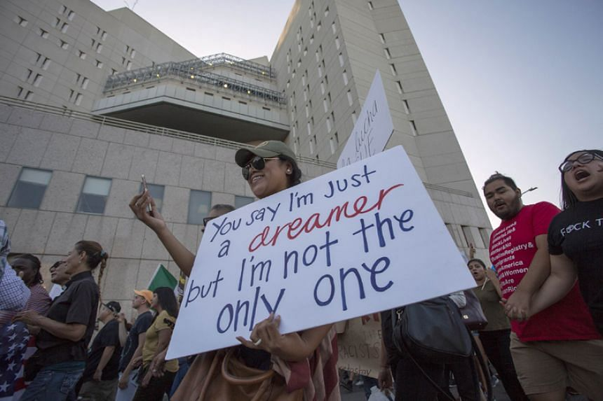 People march past the Metropolitan Detention Center, in which undocumented people are jailed, in opposition to US President Donald Trump's order end to the the Deferred Action for Childhood Arrivals programme in Los Angeles on Sept 5, 2017.