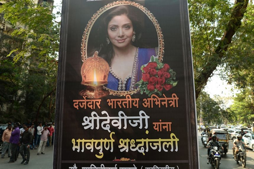 A picture of Bollywood actress Sridevi Kapoor is put up outside her residence in Mumbai on Feb 26, 2018, following her death.