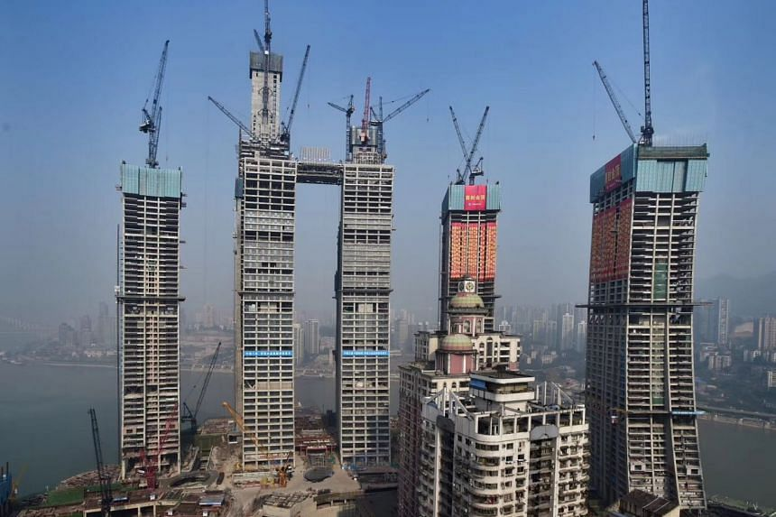Site photo of Raffles City Chongqing, which is strategically located on Chaotianmen at the confluence of Yangtze and Jialing rivers in Yuzhong District, next to the traditional Jie Fang Bei central business district.