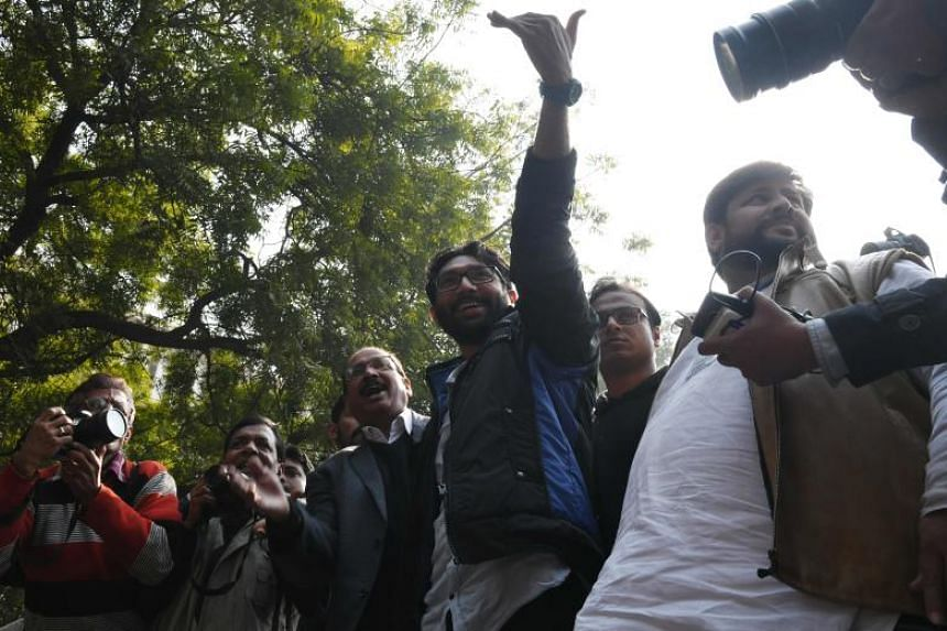 Member of legislative assembly from Gujarat and social activist Jignesh Mevani (Centre) waves to the crowd during a rally in New Delhi on Jan 9, 2018.