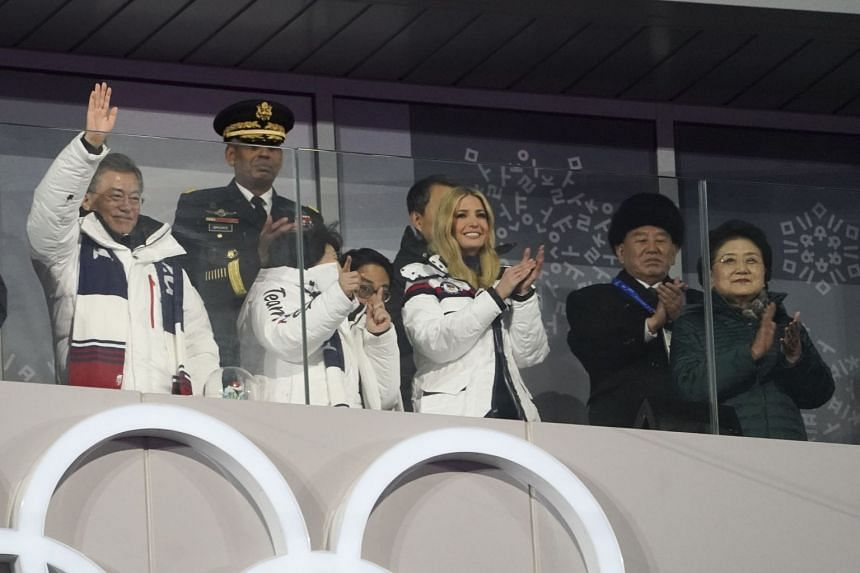 President Moon waves to the crowd with guests General Kim and US President Donald Trump's daughter, Ivanka Trump, during the Winter Olympics closing ceremony.