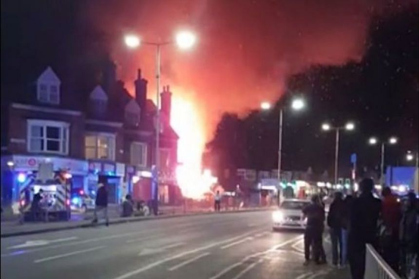 Photos and video posted on Twitter appeared to show a fire in a building in a residential street.