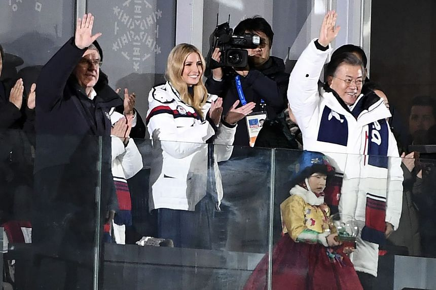 (From left) Thomas Bach, president of the International Olympic Committee, Ivanka Trump; and South Korean President Moon Jae-in acknowledge the crowd during the closing ceremony of the 2018 Winter Olympics in Pyeongchang.