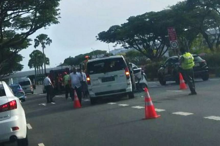 The accident, involving three taxis and two cars, caused traffic to build up on the four-lane road leading to Changi Airport for about an hour.