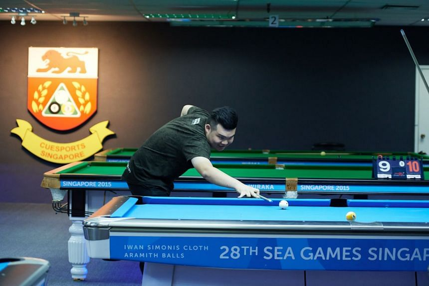 SEA games gold medallist Aloysius Yapp competing in a nine-ball tournament at the new academy yesterday.